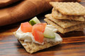 Whole wheat crackers with topping Royalty Free Stock Images