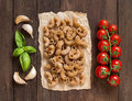 Whole wheat pasta with garlic, tomatoes and basil Royalty Free Stock Photo