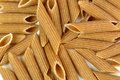 Whole wheat penne rigate pasta Royalty Free Stock Photo