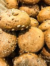 Whole-wheat rye rolls in bread basket Royalty Free Stock Photo