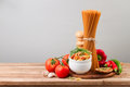 Whole wheat spaghetti and vegetables on wooden tabletop Royalty Free Stock Photography