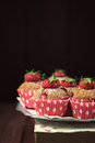 Whole wheat strawberry muffins on black background Royalty Free Stock Photos