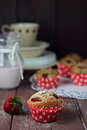 Whole wheat strawberry muffins in a rustic arrangement Stock Images