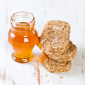 Wholegrain bisks and honey Royalty Free Stock Images