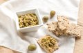 Wholegrain crackers with olive tapenade and greeen olives Royalty Free Stock Photo