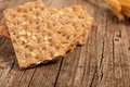 Wholegrain crispbread slices of crisp healthy lying fanned out on a rustic wooden table top with copyspace Royalty Free Stock Image