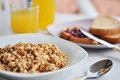 Wholegrain muesli breakfast with orange juice and bread with jam Stock Photos