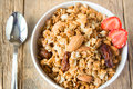 Wholegrain muesli delicious and healthy breakfast with lots of dry fruits nuts and grains close up horizontal on wooden table with Stock Photo