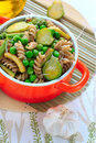 Wholegrain pasta with green vegetables in ceramic pan Royalty Free Stock Photo