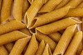 Wholegrain pasta macaroni for background Stock Images