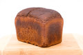 Wholemeal bread loaf of over white background Royalty Free Stock Images