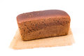 Wholemeal bread loaf of over white background Stock Photos