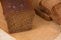 Wholemeal bread loaf of over wooden background Royalty Free Stock Images