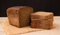Wholemeal bread loaf of over wooden background Stock Photography