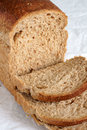 Wholemeal bread or wheatgerm hand cut in slices Royalty Free Stock Photos