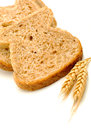 Wholemeal bread on white background with wheat Royalty Free Stock Photo