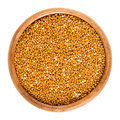 Wholemeal brown millet in a wooden bowl Royalty Free Stock Photo