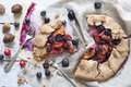 Wholemeal french galette with fruits sliced apricots peaches and blueberries on vintage rustic background with fresh fruits and ro Stock Image