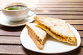 Wholemeal sandwich bread served on plate with black coffee at the background Royalty Free Stock Photo