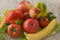 Wholesome fresh fruits and vegetables on granite platter Royalty Free Stock Photos