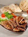 Wholesome platter of mixed meats balkan food including grilled steak Stock Photos