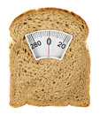 Wholesome slice of bread as weighing scale isolated on white Royalty Free Stock Photo