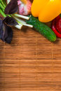 Wholesome vegetables and straw napkin macro Royalty Free Stock Photo
