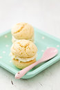 Whoopie pies with cream frosting on dotted plate Royalty Free Stock Image