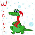 Why crocodile is so cold in winter cheerful wrapped a scarf on neck and the cap of santa on the background of a Royalty Free Stock Image