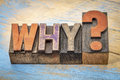 Why question in wood type vintage letterpress stained by color inks Stock Photography