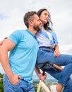Why women more attracted biker guys. Girl sit on handlebar of his bike. Man bearded macho rides girlfriend on his bike Royalty Free Stock Photo