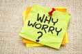 Why worry question on a sticky note against burlap canvas Stock Photos