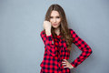 Wicked girl thritting with fist curly beautiful in plaid shirt Royalty Free Stock Images