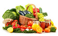 Wicker basket with assorted organic vegetables and fruits on white Royalty Free Stock Images