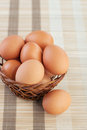 Wicker basket with chicken eggs Royalty Free Stock Image