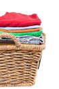 Wicker basket of clean fresh laundry filled with neatly folded washed clothes awaiting ironing close up side view isolated Stock Photography