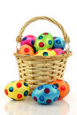 Wicker basket filled with colorful easter eggs
