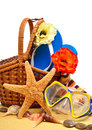 Wicker basket, flip-flops, fishstar, goggles on the towel Royalty Free Stock Photo