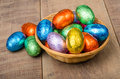 Wicker basket with foil chocolate eggs Stock Images