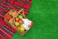 Wicker Basket With Food And Drink On the Picnic Blanket