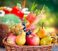 Wicker basket with fruits close up Stock Photos