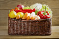 Wicker basket with fruits and vegetables on wooden table Royalty Free Stock Photo