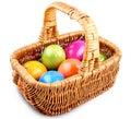 Wicker basket full of colorful Easter eggs