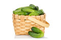 Wicker basket full of cucumbers isolated on white background Royalty Free Stock Photography