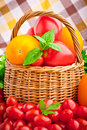 Wicker basket full of fresh tomatoes Stock Images