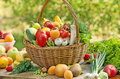Wicker basket is full with fruits and vegetables fresh organic Stock Photography