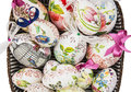 Wicker basket full of painted colorful Easter eggs