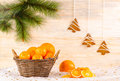 Wicker basket with oranges and christmas gingerbread Royalty Free Stock Photography