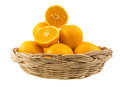 A wicker basket with oranges on white background fruits Stock Photo