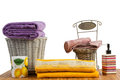 Wicker baskets full of clean colored towels basket on a wooden table in a bathroom set Stock Images